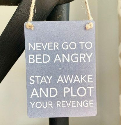 revenge metal sign